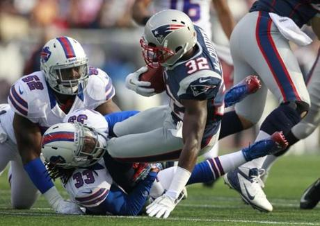 Devin McCourty was taken down by Bills cornerback Ron Brooks during the first quarter.